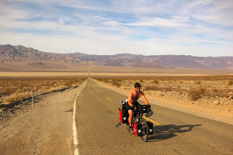 Andrew Finlay owner of Wild View Retreat Corgas Bravas Portugal riding through Death Valley